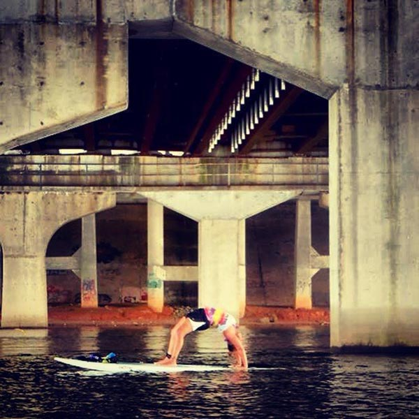sup yoga under bridge