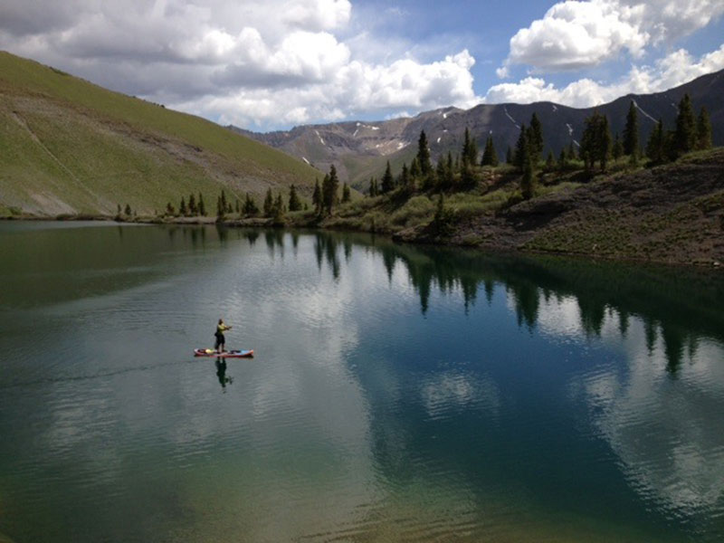 By: David Cordell Alpine fly fishing Colorado We had hiked up to 12,00 feet for three hours just to get a shot at some Big trout from our inflatable sup . It was worth it nice 20 inch Brown and then it stormed like hell . This is above Telluride Colorado :D