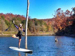 Jodelle Fitzwater sup next to tree