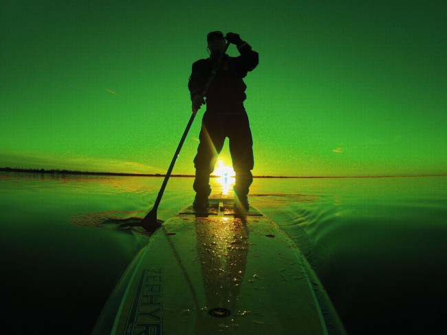 Bill Farrar was out enjoying a late February sunset paddle on Lake Hefner in Oklahoma City on his 14' Tahoe Zephyr when the sun caught the camera just the right way and created this photo.  Bill was simply taking photos to share with friends and colleagues and never knew the photo existed until he was reviewing the photos days later.  When asked if he could ever duplicate the photo, Bill said it's most likely a once in a lifetime shot.