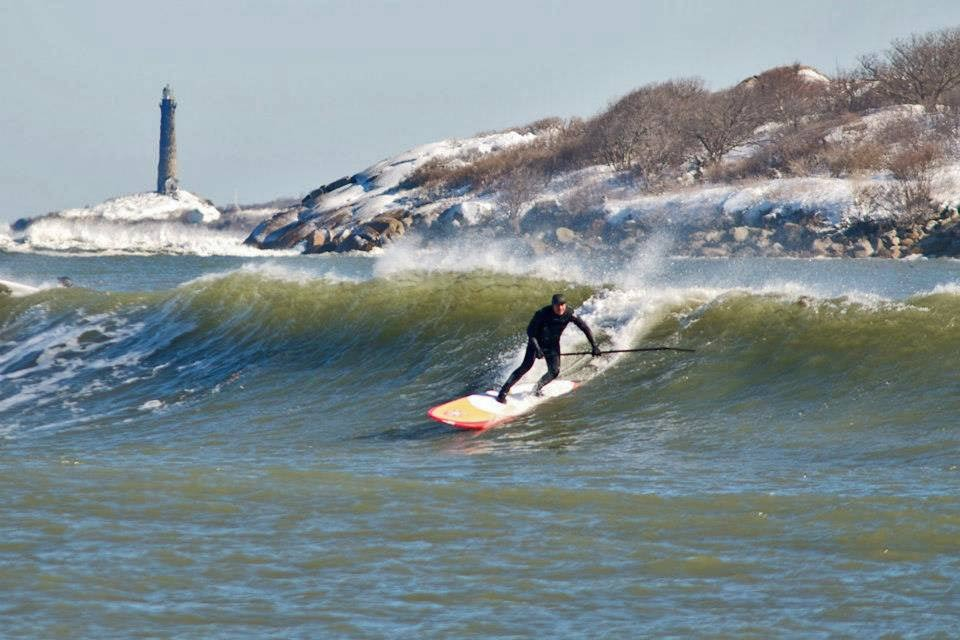 John delRosario dropping in on a cold Nemo wave last winter in Gloucester MA. My 9 year old Niece Makayla shot this pic from the shore