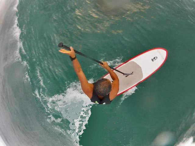 birds eye view. I attach a pole to a life vest and a go pro to the top of the pole and this is the results! rico labang supping at a secret location maui Hawaii...