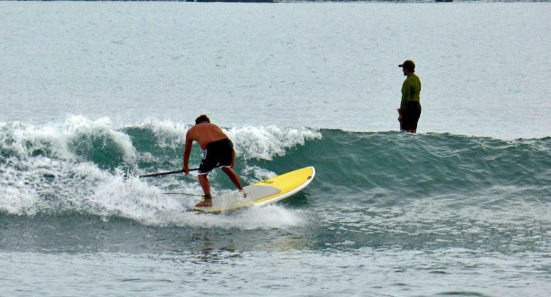 """TOKYO DRIFT"" Its like a side slip but not! drifting down the face and recovering with a bottume turn. Rico Labang supping at Kahului Harbor Maui Hawaii.............this is an inovative move created for the stand up paddle surfing world!"