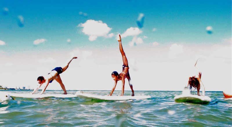 kids doing sup yoga miami kiteboarding