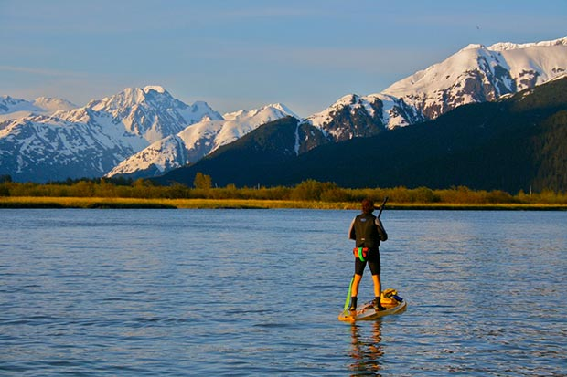 Karl Mittelstadt pauses to take in the view of Blueberry Hill after paddling 15 miles north of Girdwood to 20 mile river - on an Up Tide Adventure June 2012 Photo JAKE YOUNG