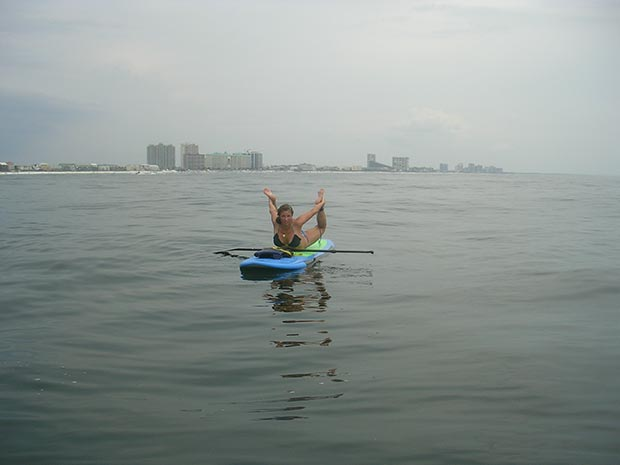 Katie Buettner 2013 at Miramar Beach Florida. about 5 miles from shore playing around with some yoga poses. This one is an awesome body opener. Bow Pose!