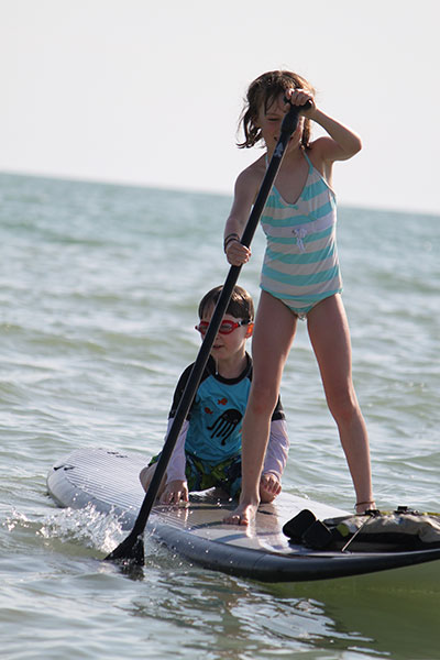 Kristina Butterworth: Hitching a ride! Ben, 5, catches a ride with big sister Sasha, 8. Bonita Springs, Florida.