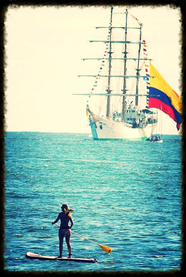 "Malena Mazzoni ""Saluting a Colombian Frigate"". This picture was taken this year (February 2014) in Punta del Este - Uruguay I was paddling and a huge Colombian Frigate appeared in the horizon and then came closer, the flag was incredibly big. After a long and hard year, relaxing and paddlesurfing in Uruguay! Perfection!"