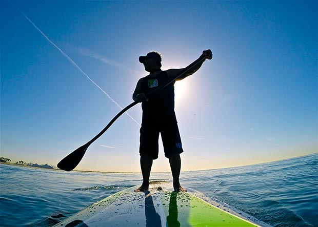 "Wayne Limm After several days of unusually high Santa Ana winds, we were blessed with a glassy, calm Southern California morning. An impromptu gathering of paddle buddies took off on a relaxing paddle from Cabrillo Beach to ""Palms"". About a 6 miles round trip. Along the way I learned about San Pedro history from long time local surfers turned standup paddlers. Love this sport and the friendships that are easily made. Picture is me backlit and silhouetted."