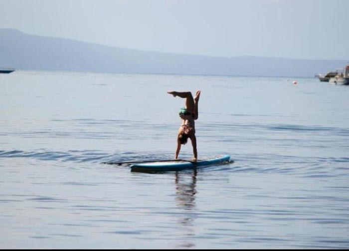 Andrea Wallace A love for handstands! This photo was taken in South Maui on a beautiful November morning.