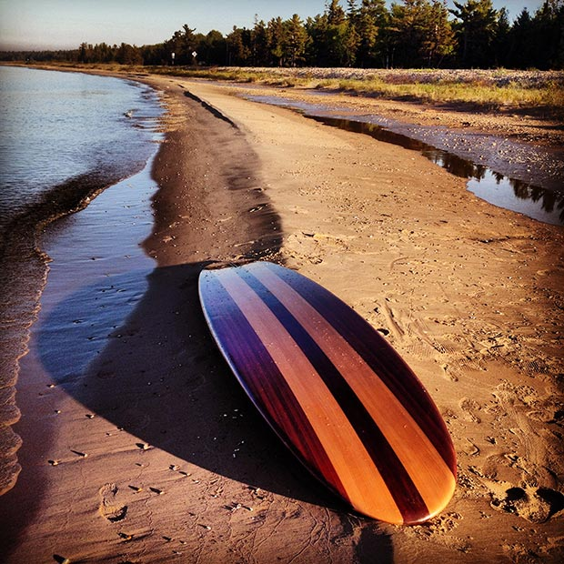 Lori Acre: Malibu of the Midwest - My board after an early morning paddle on Lake Huron's shore , 1/4 mile Beach just north of Rogers City, Michigan . Lake Huron is an untapped SUP paradise.