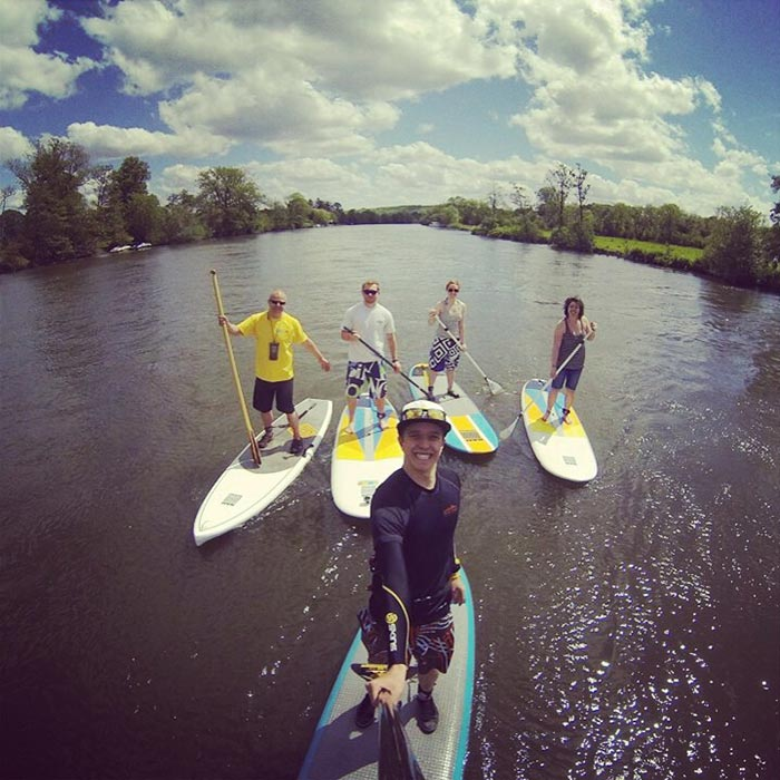 Oliver Denton Team GUSU out paddling on the River Thames. Looks like a good time for a SUP Selfie!