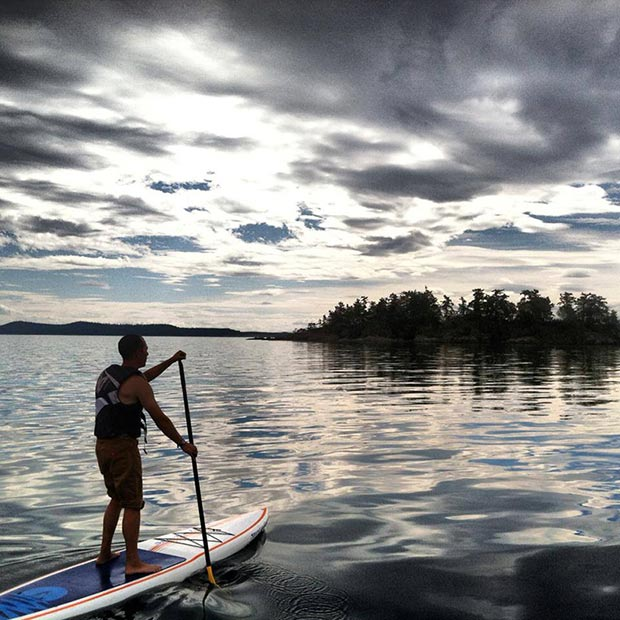 tony anderson Scotty Leighton on his way to Dinner, island. Behind the main island are Lunch and Dessert islands - home to a family of nearly 50 Harbor Seals. San Juan Islands, WA. Photo courtesy of Springtide Paddlesports.