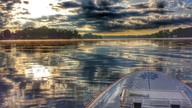 Brandon German: Sunrise and steam on Cedar Island Lake, Michigan.