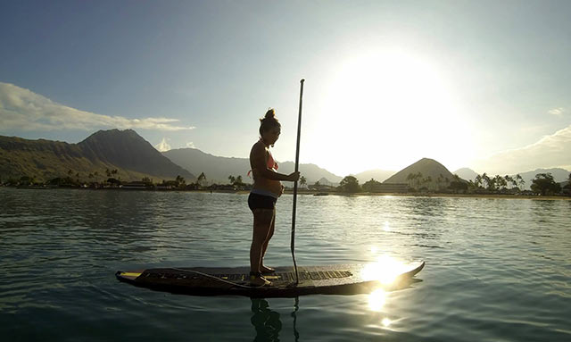 George Kalilikane: Morning paddle with Cherish as baby kicks at Bay of Dreams, Pokai Bay, Waianae HI.