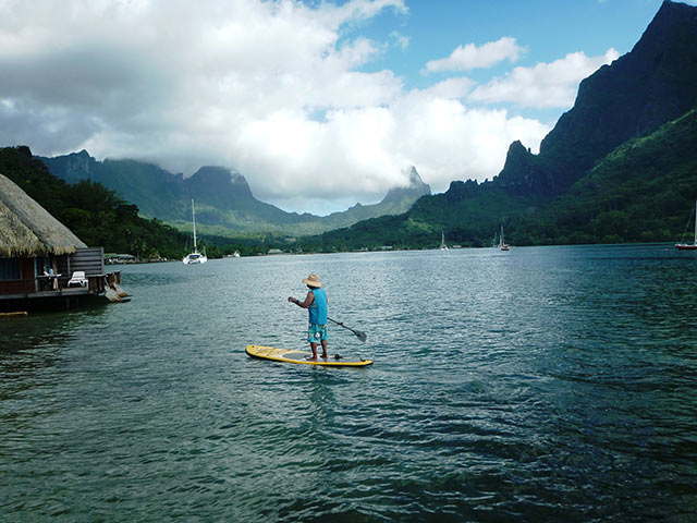 Gina Umipig: Frank Umipig - Bora Bora Even though he makes custom SUPs at home, Frank had to bring an inflatable stand up paddle board with him on vacation to Moorea, Tahiti. Surrounded by volcanic peaks, the views from Cook's Bay were dramatic.