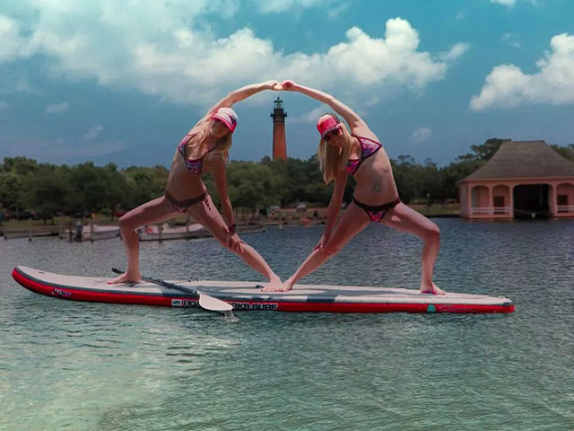 Jackie Miller: Got Trust Issues?? We don't!! This photo is of my sister and I enjoying some SUP yoga in the outer banks, NC . (Before our hair got wet)