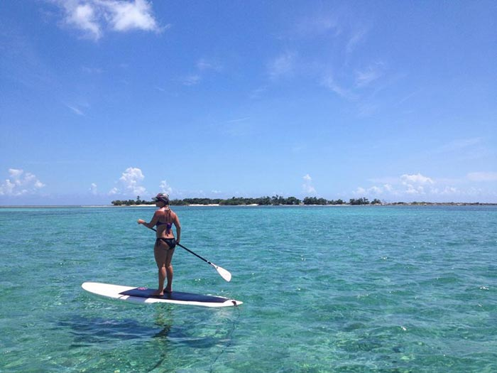 "Jessica Keaton: SUP Happy Place! This picture of Jessica Keaton were taken in the Abacos. The water was 9-10ft but was so crystal clear it seemed to be only inches deep. Two sharks came cruising by and a ton of other sea life was spotted, including stingrays, conch, starfish, corals, and many tropical fish. An amazing experience and certain to be a ""Happy Place"" for me to seek peace and harmony for years to come!"