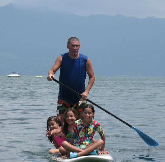 Jorge Dominguez: When there is only one board, no option but to share...but it's fun. Lake Ilopango, El Salvador
