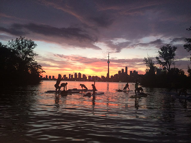 Lynne Stewart: Final yoga pose in the sunset after a storm (Toronto Skyline). Photo courtesy of SOLSUP