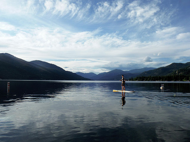 Merielle Kazakoff: My partner in life and SUP heading out for the perfect June evening paddle on Christina Lake, BC.