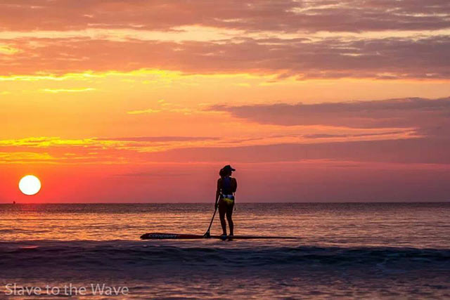 "victoria burgess: ""Daydream"" This photo was of myself, victoria burgess, taken off ft lauderdale beach during sunrise in january 2014. It should be considered because it caputures the early morning tranquility and beauty of a sunrise SUP."