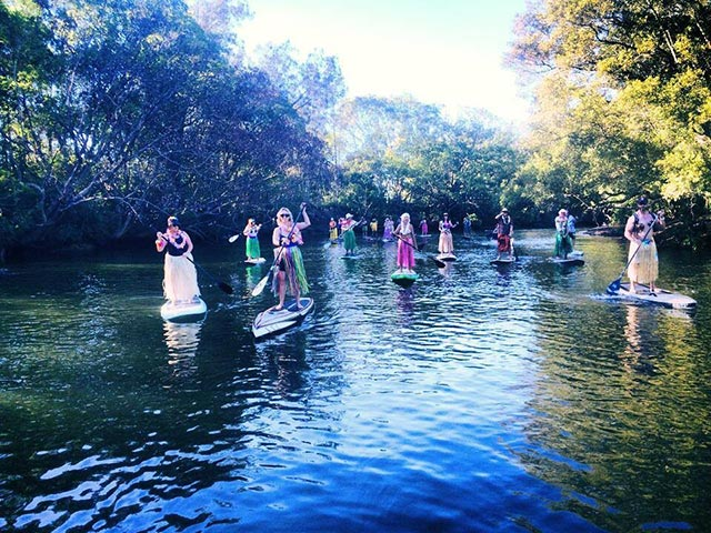 Anna Irvine: Paddling Hawaiian Tiki Doll style: We always try to have fun when we are paddling . This is our group PaddleBoard Gold Coast, paddling in a fun charity race on The Brunswick River, Australia in May of this year.