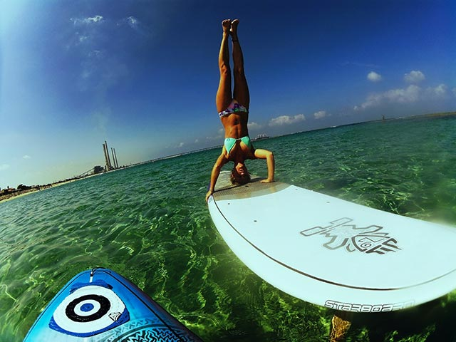 """Becky Sassoon: SUP-Side-Down I'm a creative person and never satisfied with """"This is how it should be done!"""" A morning paddle is how I start my day, but this time I decided to try a new way of looking at the world on water. Taken at Sdot-Yam beach in Israel, By Lee Frydman."""