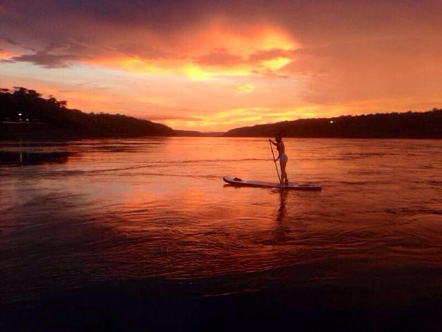 Bruno Carrenho: Sunset at Foz do Iguaçu, Paraná, Brazil. The girl at the sup is my friend Hanadi Hanze having her first lesson. At the right side is Paraguay and at the left side is Brazil. The Paraná River is one of the biggest rivers of Brazil and that makes practicing sup a difficult task.