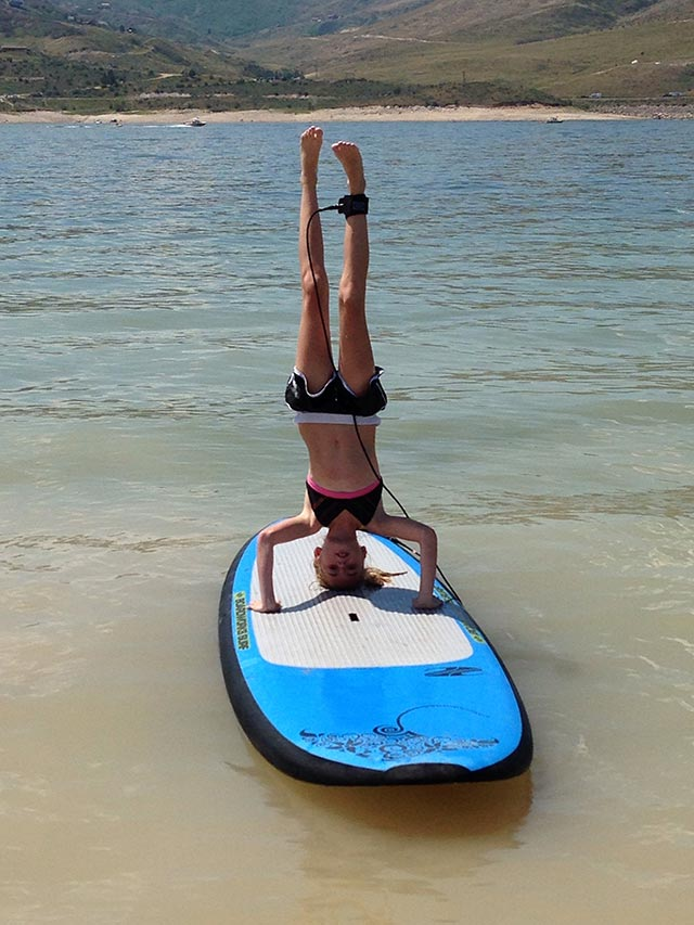 Casey Fullmer: 12 year old first time paddle boarding. Rockin the headstand!