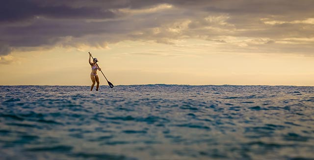 Derrick Lopez: My wife, Sunshine, first ride on her SUP at Makaha Surfing Beach, Hawaii.