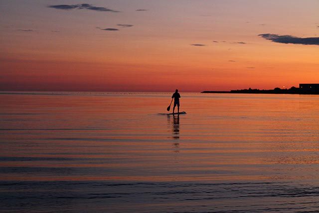 Henrik Malmberg: Summernight in Sweden. Paddles home in peace and harmony in the sunset.