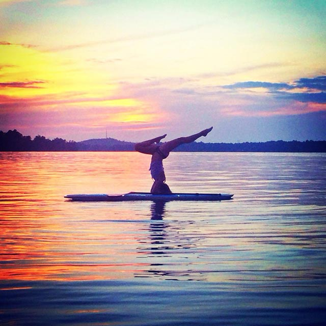 Katie Jacobson: A few of my favorite things. Yoga, paddle boarding, and sunsets are all things that define me and my life. This picture captures a spot on illustration of who i am.