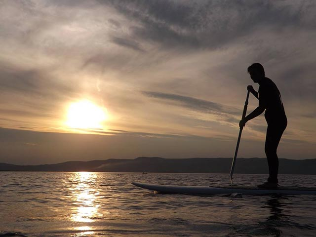 Katie Lavery: Never too old to try something new, my son taught me to sup, loving it.