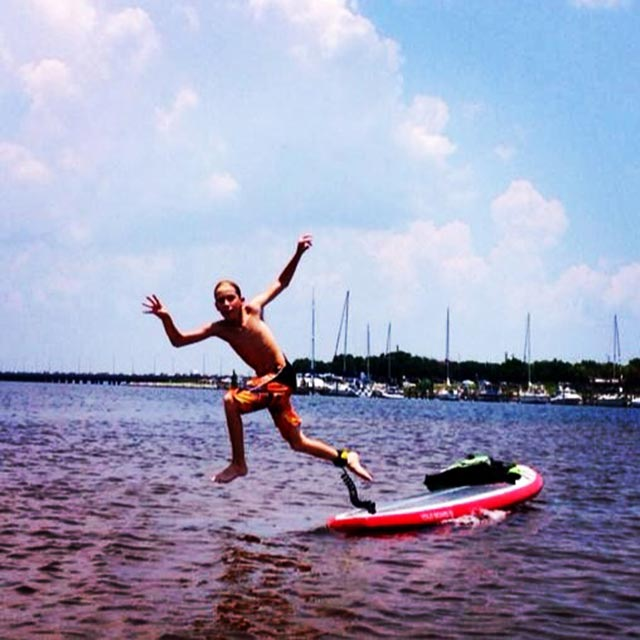Laura LeNoir: Chase, my 11 yr old, being a boy, but throughly enjoying his YOLO board while cruising the bay in Gulf Breeze, Florida.