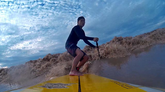 Leo Hendry Michael: Local paddlers, Leo, SUP surfing a Tidal Bore or locally known as 'Benak' in Batang Lupar River, Sri Aman, Sarawak, Malaysia (28 July 2014).