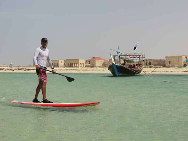 Marco Pires: Qatar desert Marco paddling in August. Near Goast Town in Qatar, because is exotic place.