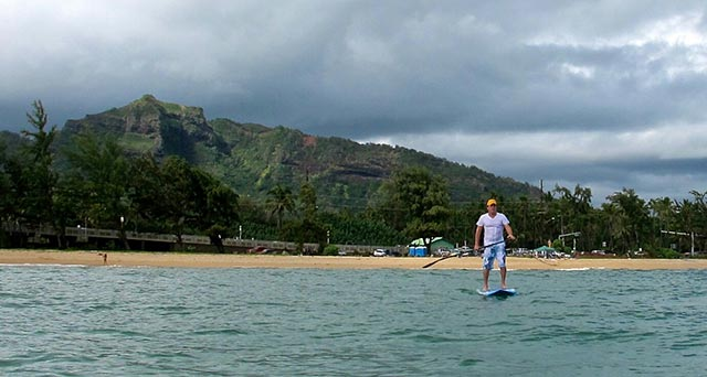 Perry Hartley: Wailua Bay , Kauai The mountain behind me is called Nonou. It translates to The Sleeping Giant who, according to Hawaiian legend, fell asleep there after a feast and great revelry ....and has yet to wake. Photo: Eric Blaum