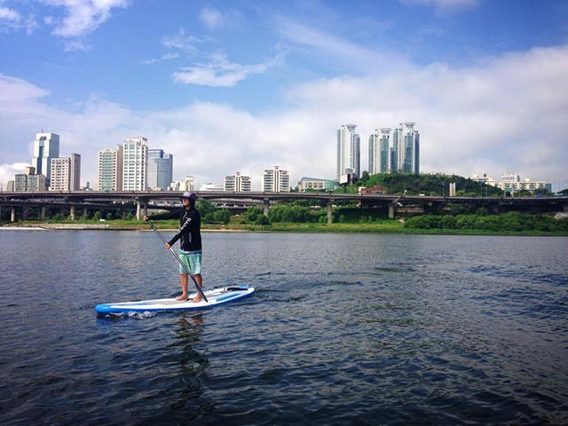 Sam Choi: Finding peace in the city, SUP in Han River. Seoul, South Korea. -Photo by JaeHo Lee
