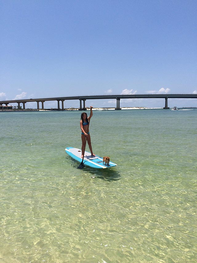 Sarah Mcaleer: My daughter Milla and her pup Journey. We live in Orange Beach Alabama, this is out favorite spot to paddle.