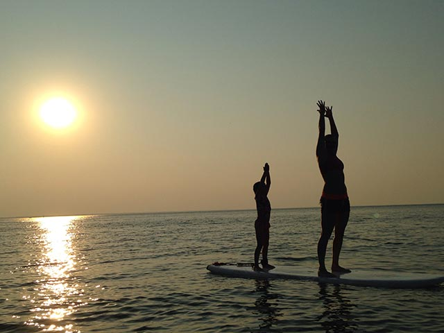 Emily F: Mommy and daughter doing some sunset yoga on Lake Huron.
