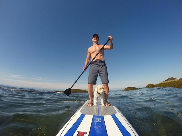 "James Askew: Paddling the Sunshine Coast, BC with constant companion, ""Kimo"" August 2014."