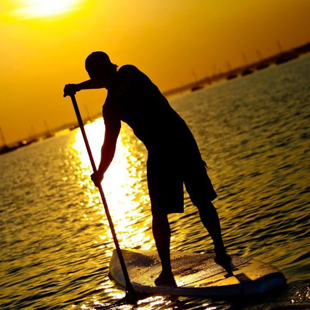 Jon Caunter: Me Stand up paddleboarding in Poole Harbor. Such a perfect evening!