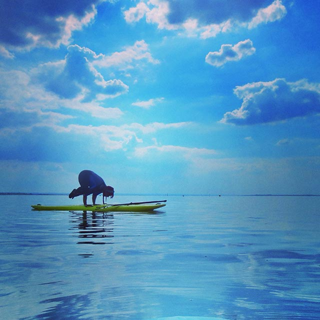 Nikki Austin: SUP yoga of Whitstable beach in uk. I'm a yoga teacher and thought I'd have a bit of fun on the board. Solstice day,the water was so calm and the weather just perfect.
