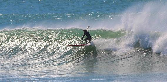 2 Turning into the wave and setting a high-line to gain speed to beat the section-