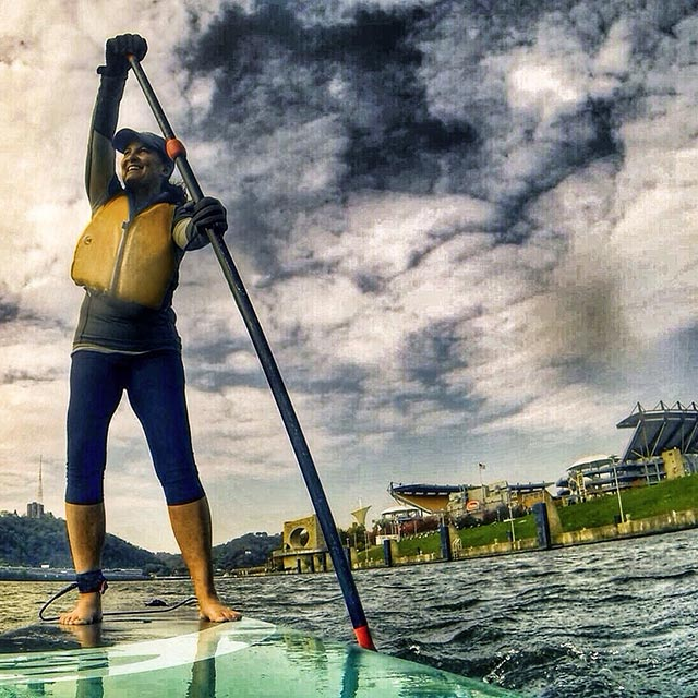 """Pittsburgh native Carrie Bregar who was home visiting from Alabama is getting back the football spirit as she paddles the Three Rivers past Heinz Field. """"Yinz"""" guys it was a great day for a Paddle!"""