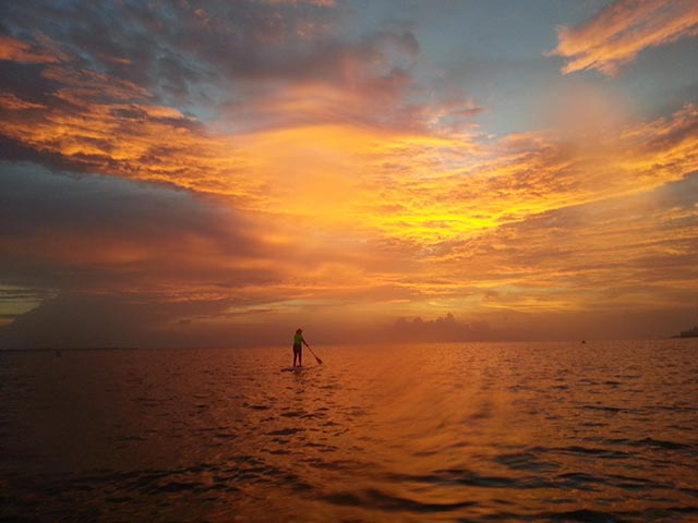 Cynthia Isunza: Good morning from Cancun Mexico! We are a group of moms who love to paddle as soon as the sun start showing its magnificent power. I took this picture during a beautiful morning paddle session while heading to Isla Mujeres.