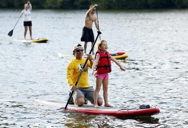 Gina Simpson: Pure Bliss on the Black Warrior River in Tuscaloosa, AL. as Mark Simpson takes his 6 year old daughter, Della, out on the group paddle. Breathe in the excitement!