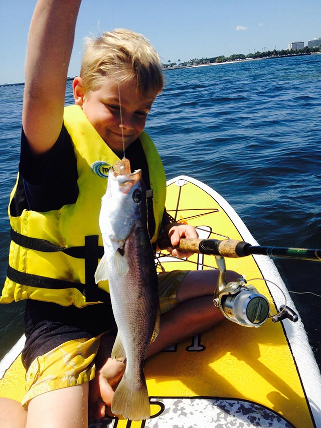 Jody Ellis: Blue fish, smiles, and blue waters! Casen Ellis is all grins while learning how to SUP fish. A big fish makes everyone smile. The water is cooling down in the Saint Petersburg flats, but fishing and paddling is heating up! Teaching and sharing my knowledge of fishing, and paddling with my son creates a life long bond between us.