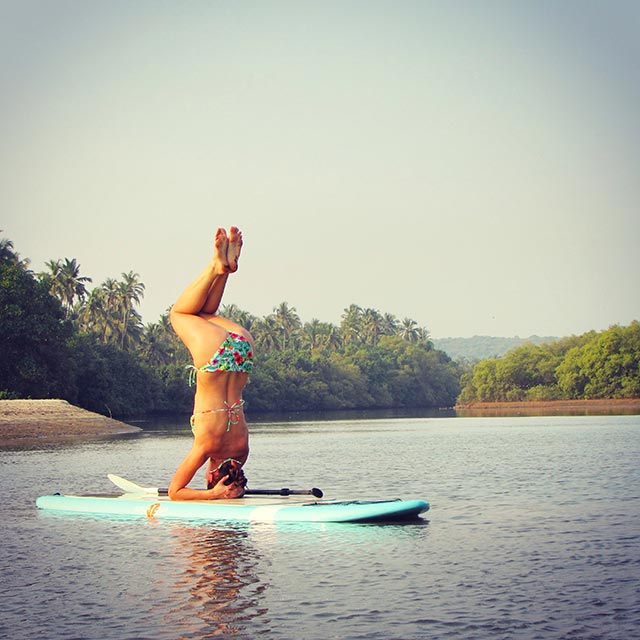 Kasia Richter: SUP yoga in Vayuu Watermans Village, North Goa, India. The only place in Goa renting out SUP boards, the community is slowly growing.